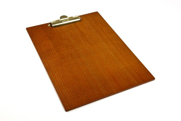 wood clip boards for a bespoke suit tailor